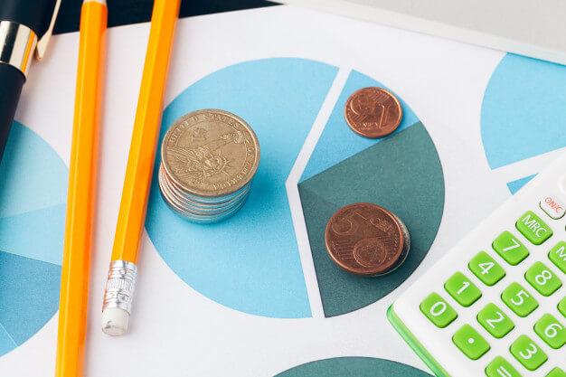 indicadores imobiliarios moedas papeis lapis e calculadoras
